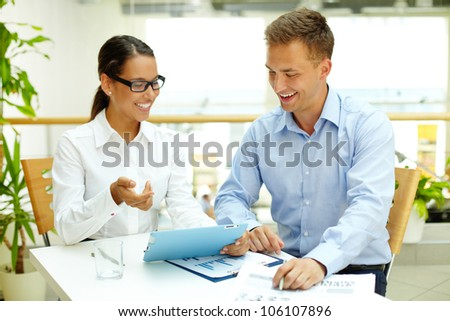 Smiling woman demonstrating the advantages of modern technology before hard copies - stock photo