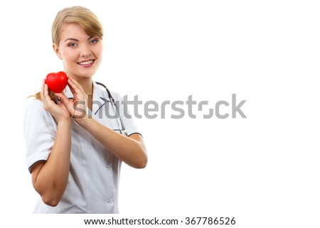 Smiling woman doctor cardiologist in white apron with stethoscope holding red heart, copy space for text, healthcare and medicine concept, white background - stock photo