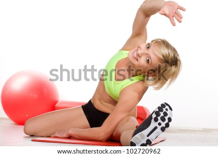 Smiling woman doing fitness exercise - stock photo