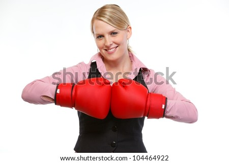 Smiling woman employee in boxing gloves - stock photo