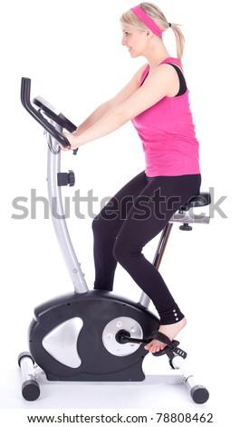 smiling woman exercising on stationary training bicycle - stock photo