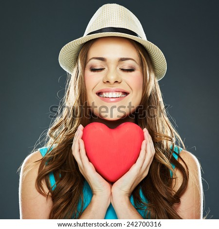 smiling woman face . red heart . valentine day concept . - stock photo