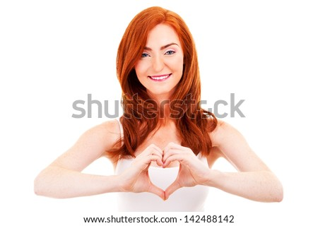 Smiling woman forming a heart with her hands