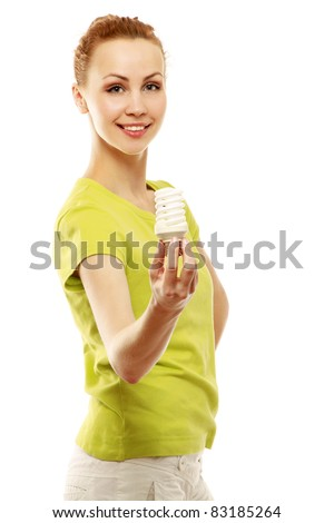 Smiling woman giving energy-saving bulb, a full-length portrait isolated on white - stock photo