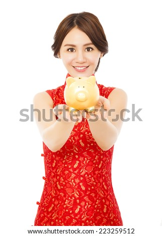 smiling woman holding a golden piggy bank . happy chinese new year.financial concept - stock photo