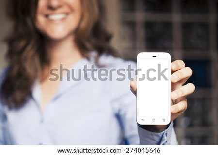 Smiling woman holding a phone in the hand. White screen with copy space.