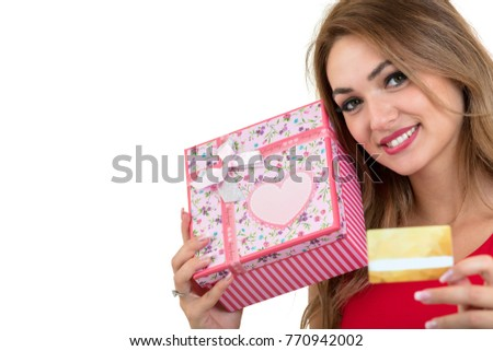 Smiling woman holding bank card and gift box isolated on a white background