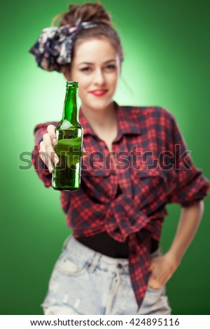 Smiling woman holding beer bottle