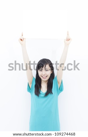 Smiling woman holding blank billboard