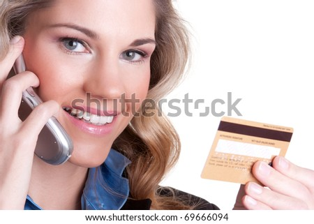 Smiling woman holding credit card - stock photo