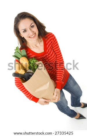smiling woman holding grocery bag; healthy food - stock photo