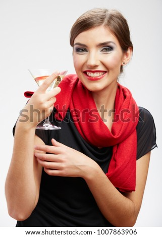 Smiling woman holding martini glass with alcohol. isolated female portrait with red scarf.