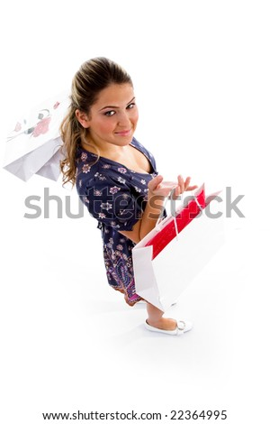 smiling woman holding shopping bags on an isolated white background - stock photo