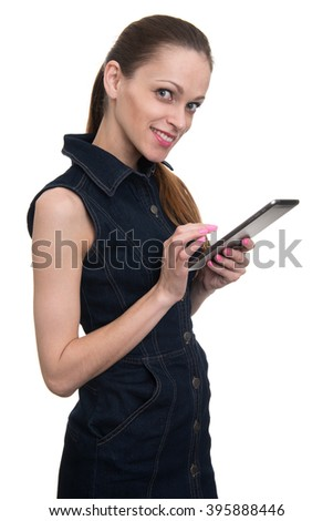 Smiling woman holding tablet computer isolated on white background. working on touching screen. - stock photo