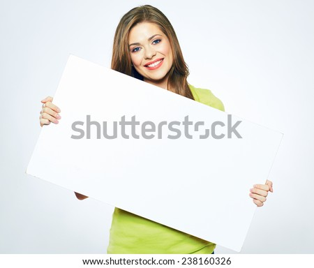 smiling woman holding white  sign board. portrait of smiling young model with long hair. isolated girl portrait.