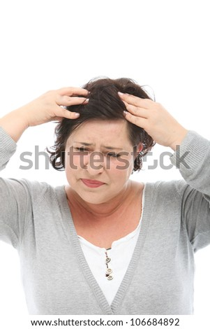 Smiling woman holds a world globe close to her head as she dreams of going on a long vacation sightseeing to worldwide destinations - stock photo