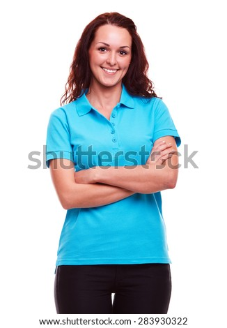 Smiling woman in blue polo shirt with arms crossed, on a white background - stock photo