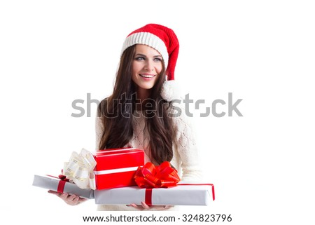 Smiling woman in santa helper hat with many gift boxes on white background. - stock photo