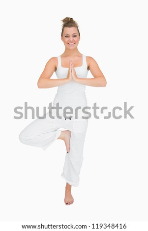 Smiling woman in standing yoga pose