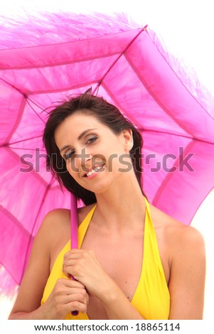smiling woman in swimsuit with colorful sunshade - stock photo