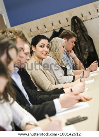 Smiling woman in the classroom - stock photo