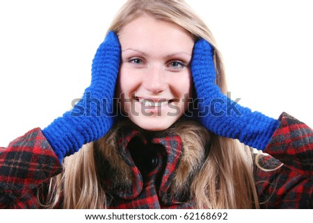smiling woman in winter coat and mittens