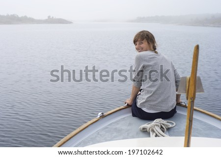 Smiling woman on boat, Sweden