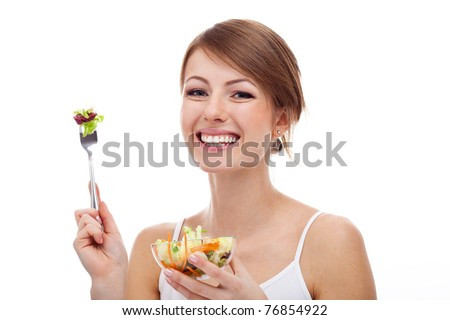 Smiling woman on diet with salad on fork, isolated - stock photo