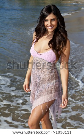 Smiling Woman on the Beach - stock photo