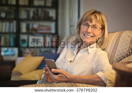 Smiling woman on the sofa