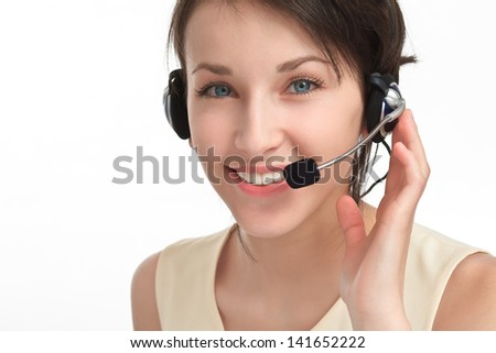 smiling woman operator with headset - microphone and headphones, on white - stock photo