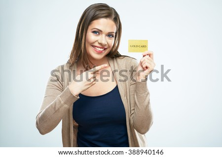 Smiling woman pointing finger on credit card. White isolated portrait. - stock photo