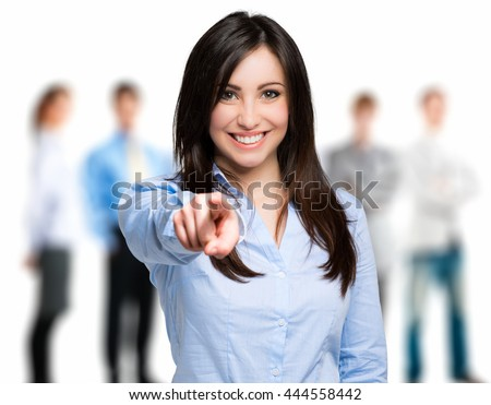 Smiling woman pointing her finger to you - stock photo