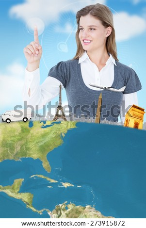 Smiling woman pointing something with her finger against digital security hand print scan - stock photo