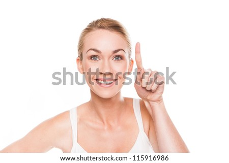 Smiling woman pointing with her finger to blank copyspace above her head isolated on white - stock photo