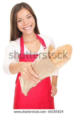 Smiling woman sales clerk giving baguette bread to customer (camera). Isolated on white background. - stock photo