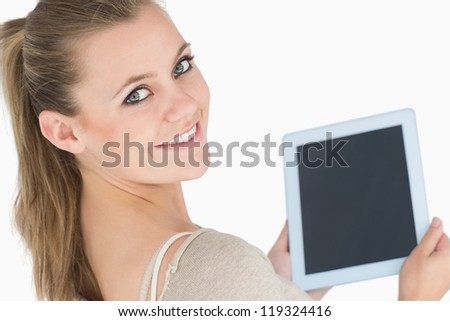 Smiling woman showing a screen tablet in the white background