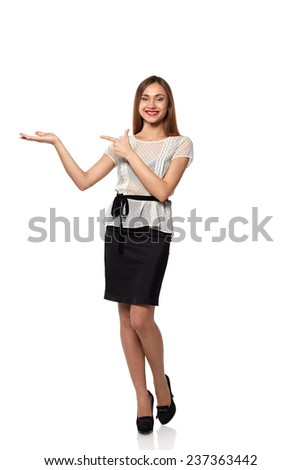 Smiling woman showing open hand palm  space for product or text - stock photo