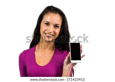 Smiling woman showing smartphone screen while looking at camera on white background