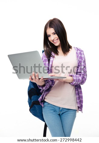 Smiling woman standing with laptop over white background