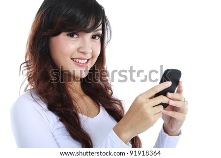 Smiling woman texting on cell phone portrait isolated on white background