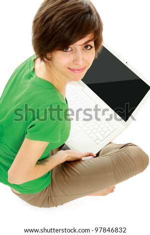 Smiling woman using laptop while sitting on floor isolated on white background,top view - stock photo