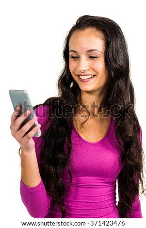 Smiling woman using smartphone standing on white screen