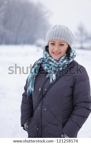 Smiling woman wearing a hat in the winter