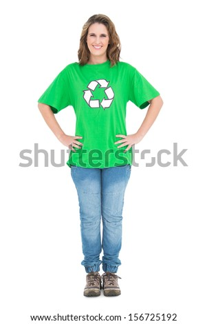 Smiling woman wearing recycling tshirt posing on white background - stock photo