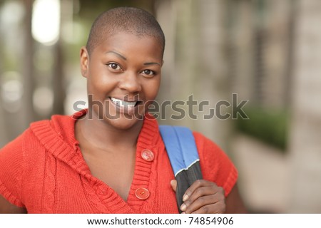 Smiling woman with a backpack - stock photo