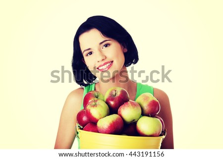 Smiling woman with apples - stock photo