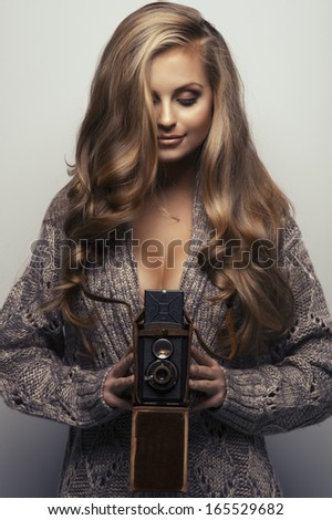 Smiling woman with camera