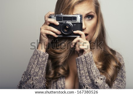 Smiling woman with camera - stock photo