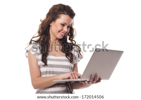 Smiling woman with contemporary laptop